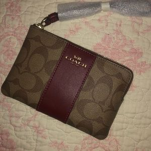 Coach wristlet in traditional canvas